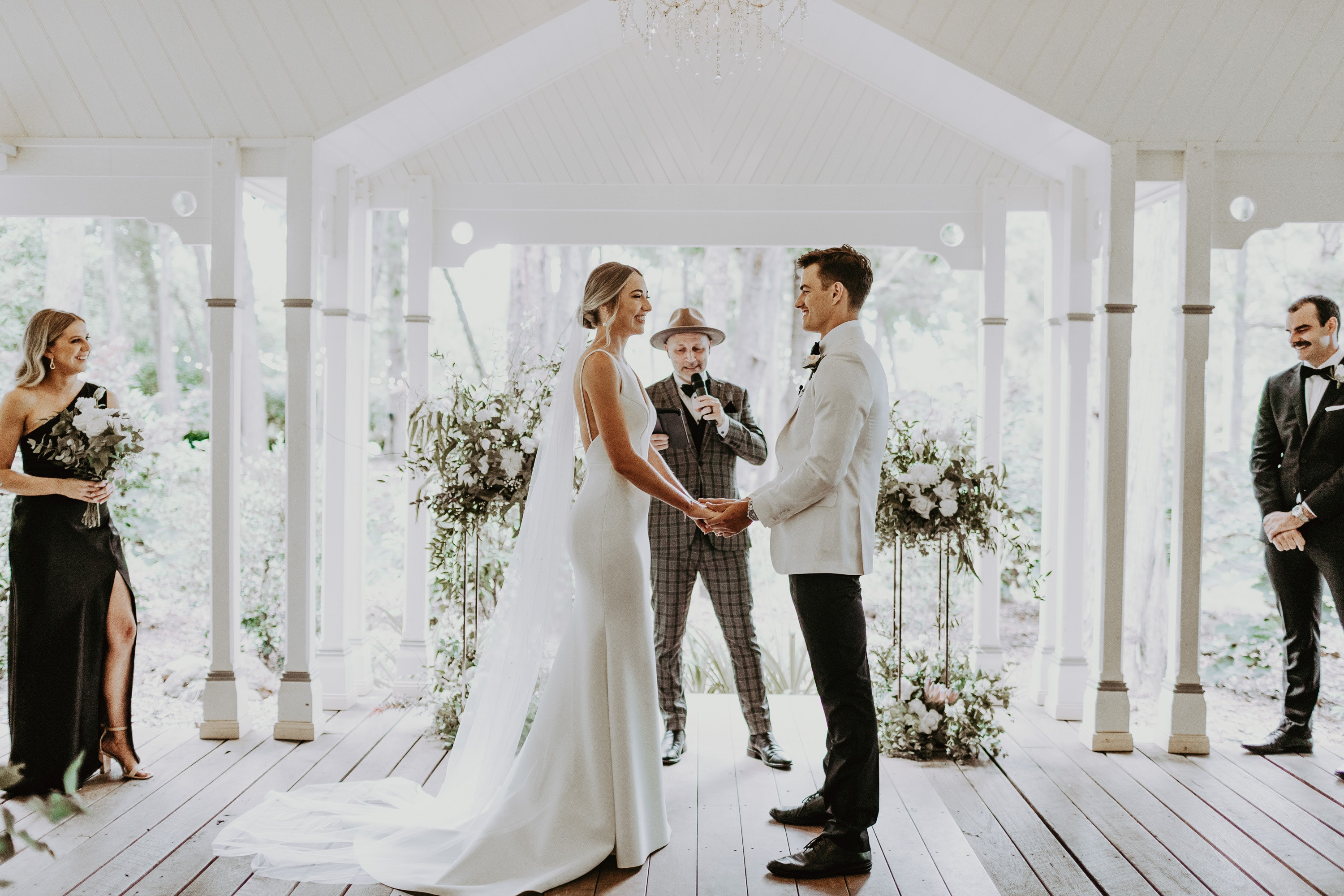 Bride and groom standing at aisle exchanging vows