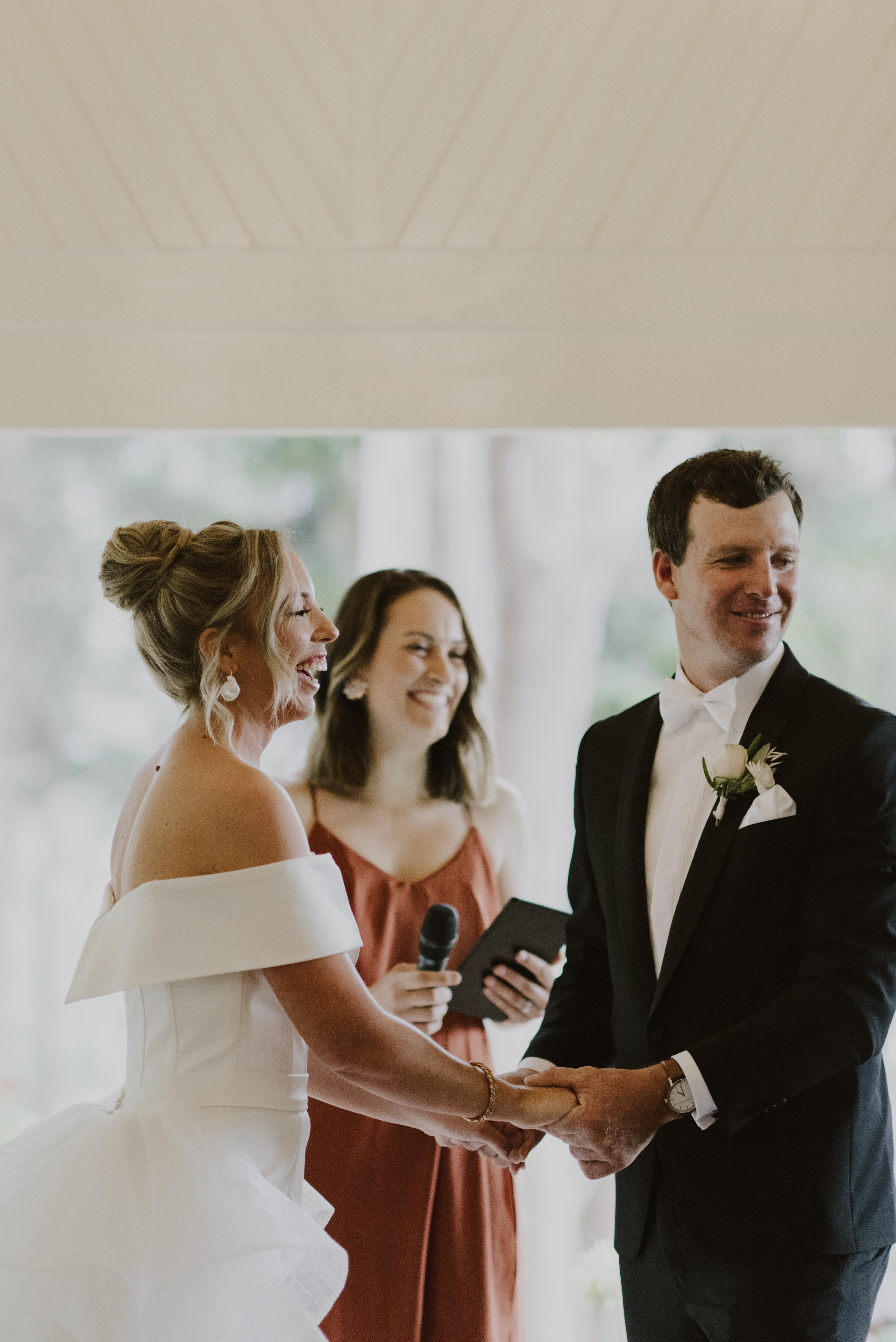Bride holding grooms hand exchanging vows