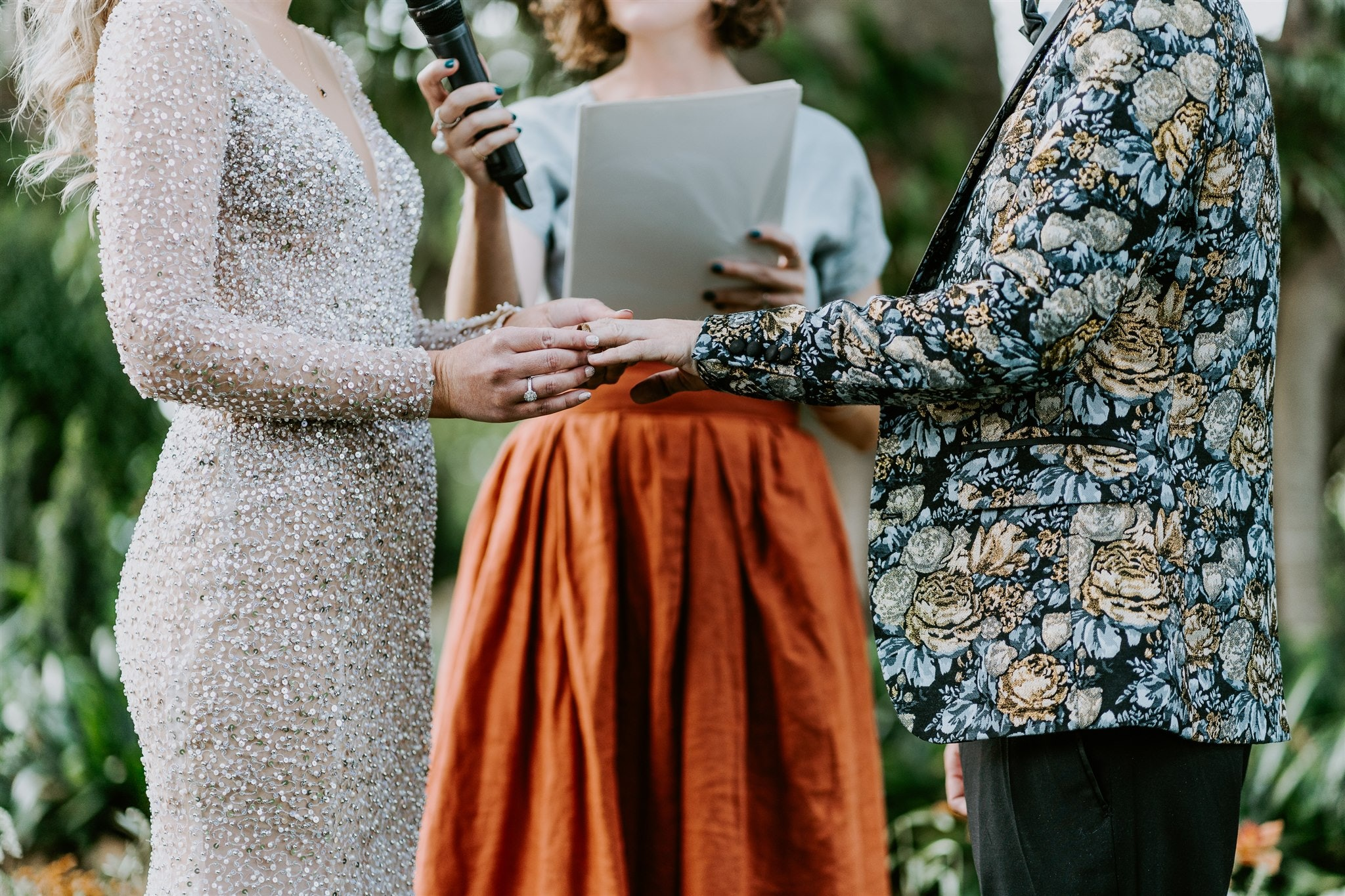 Bride and groom exchanging rings at ceremony