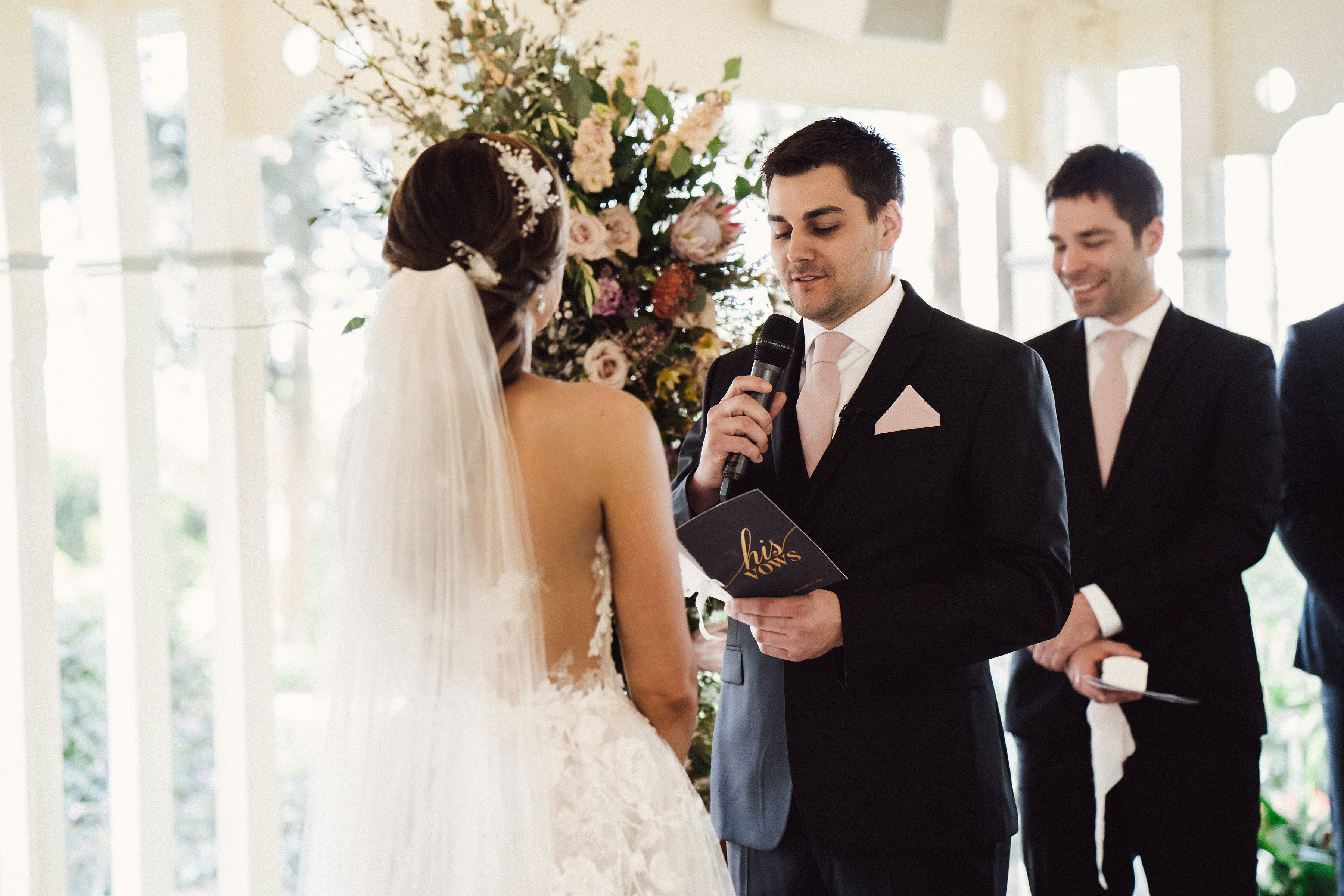 Groom reading vows to wife