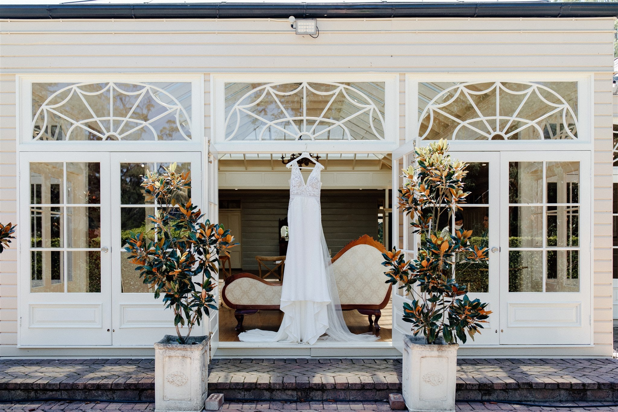 Wedding dress hanging in Conservatory