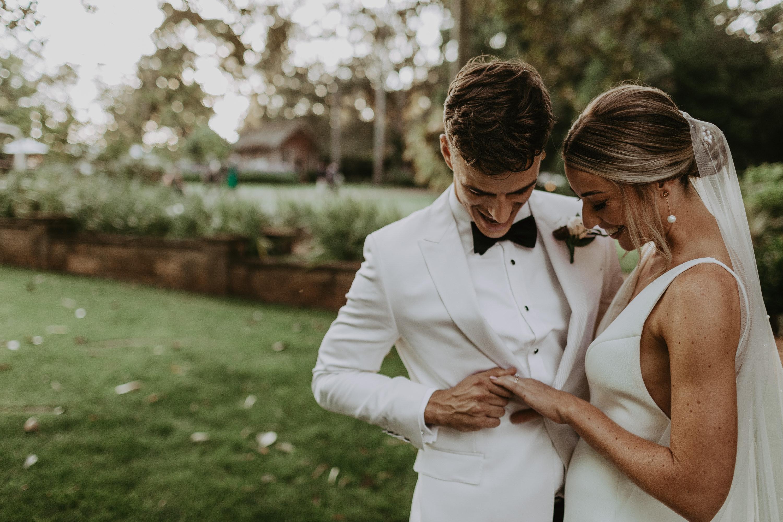 Bride and groom looking at rings