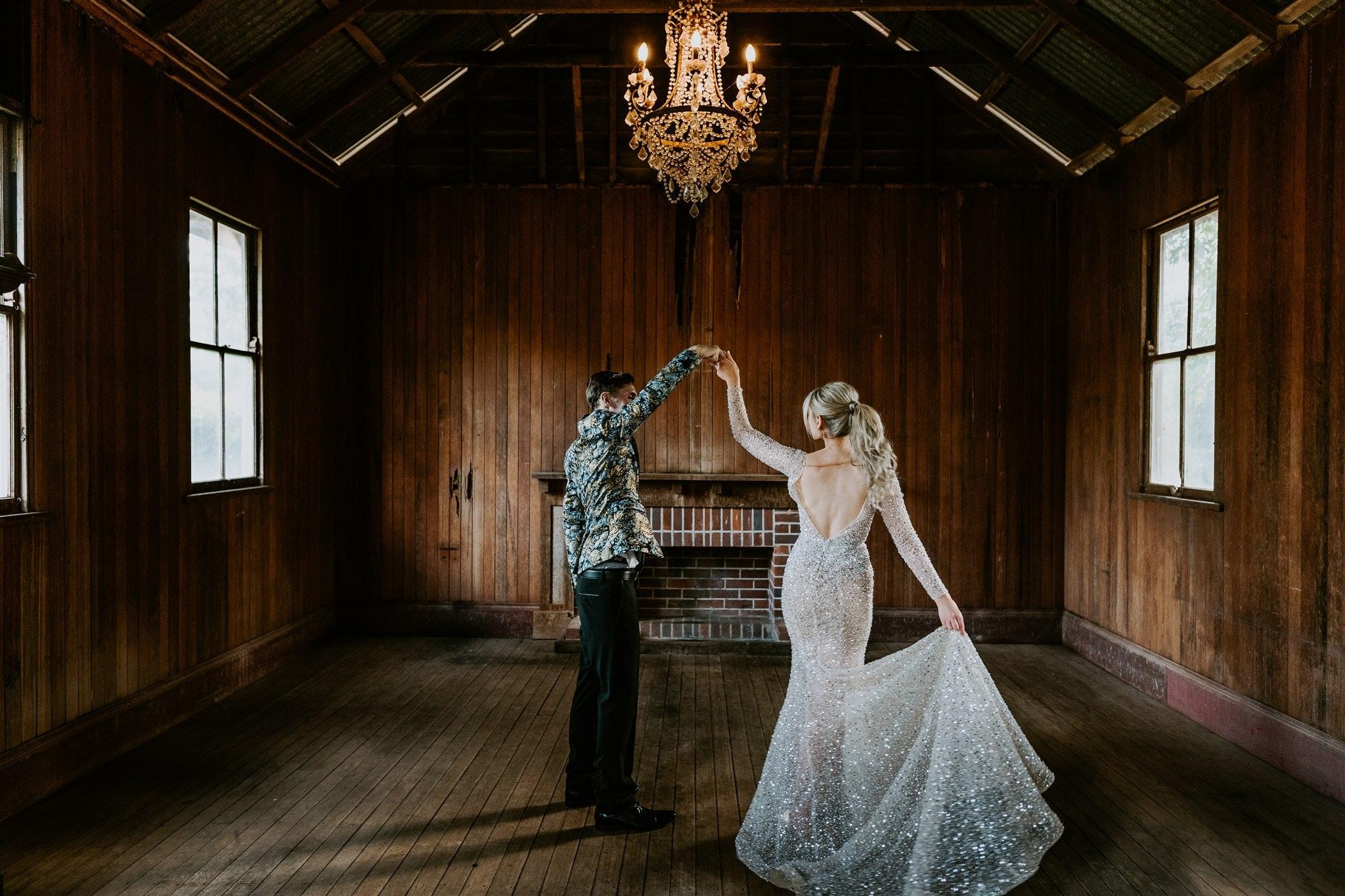 Bride and Groom dancing in Old School House