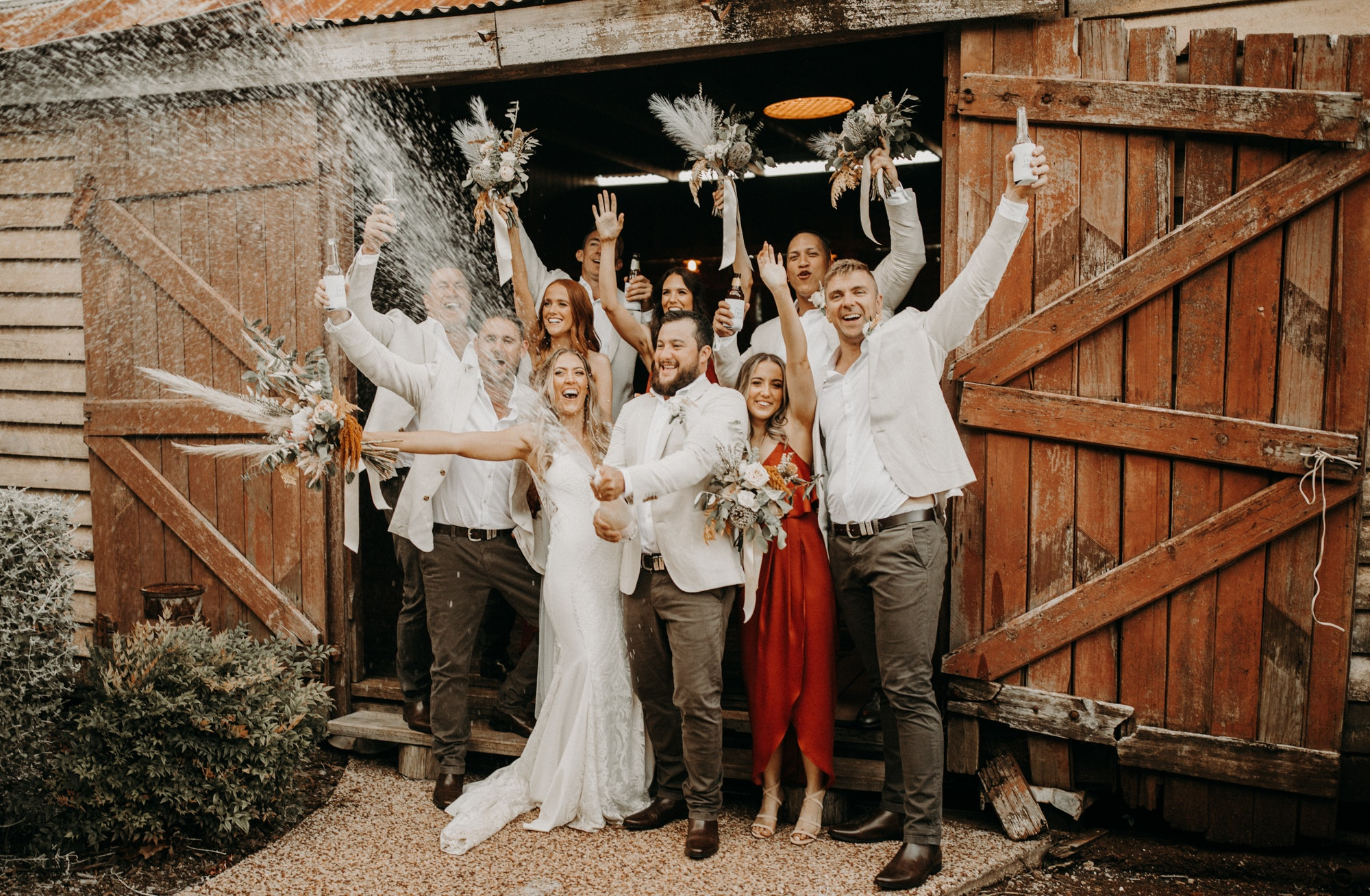 Bride and groom standing with wedding party