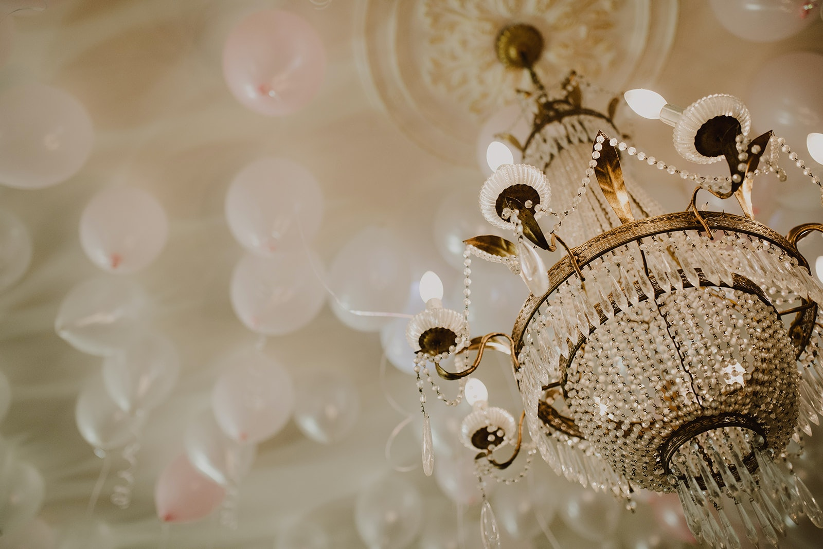 Chandelier with balloons in background