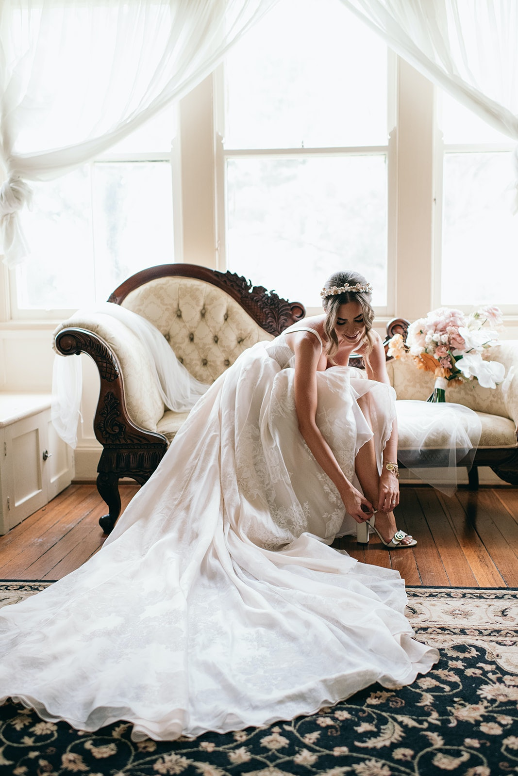 Bride doing up her shoes