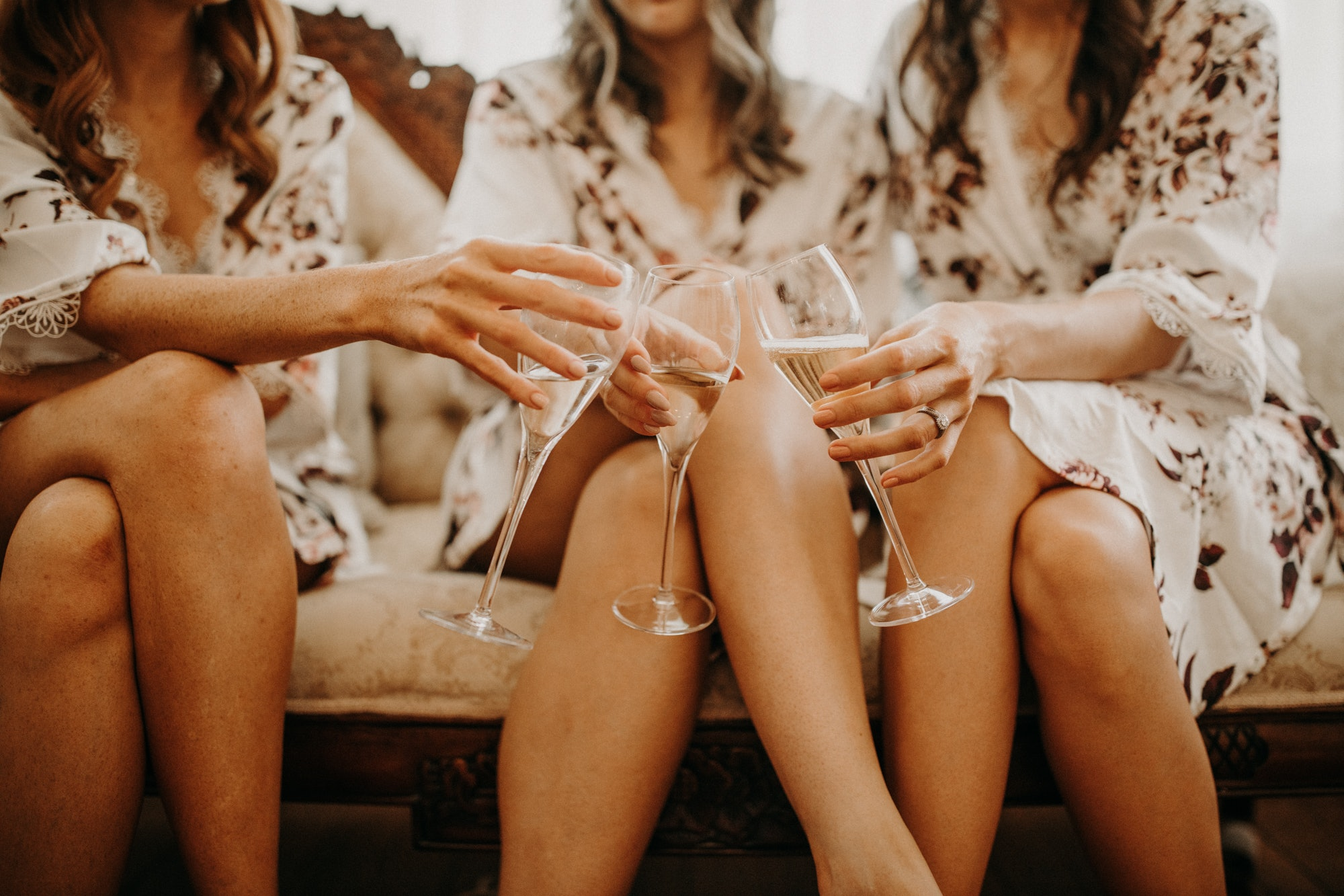 Bridesmaids holding champagne glasses