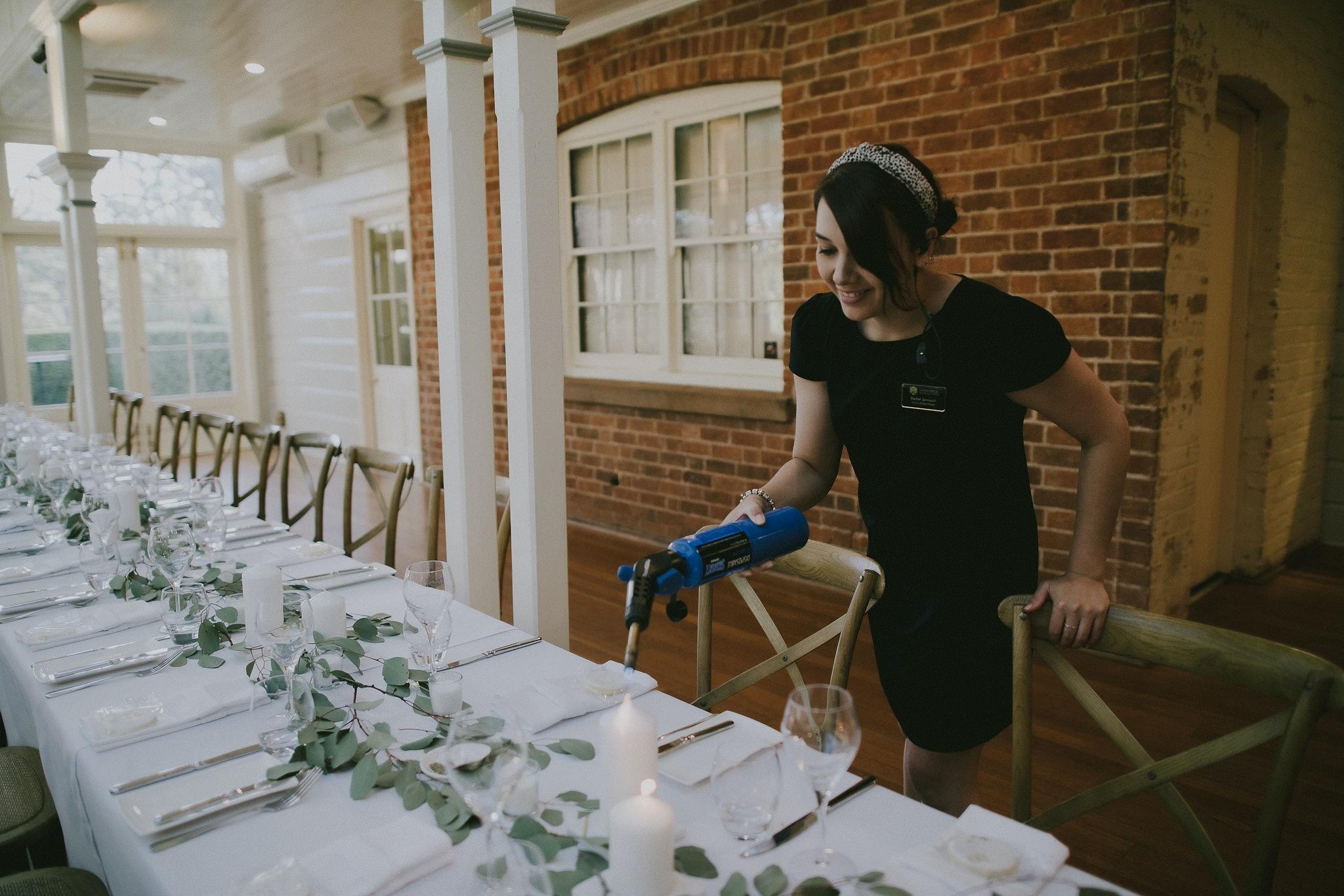 Wedding planner lighting candles