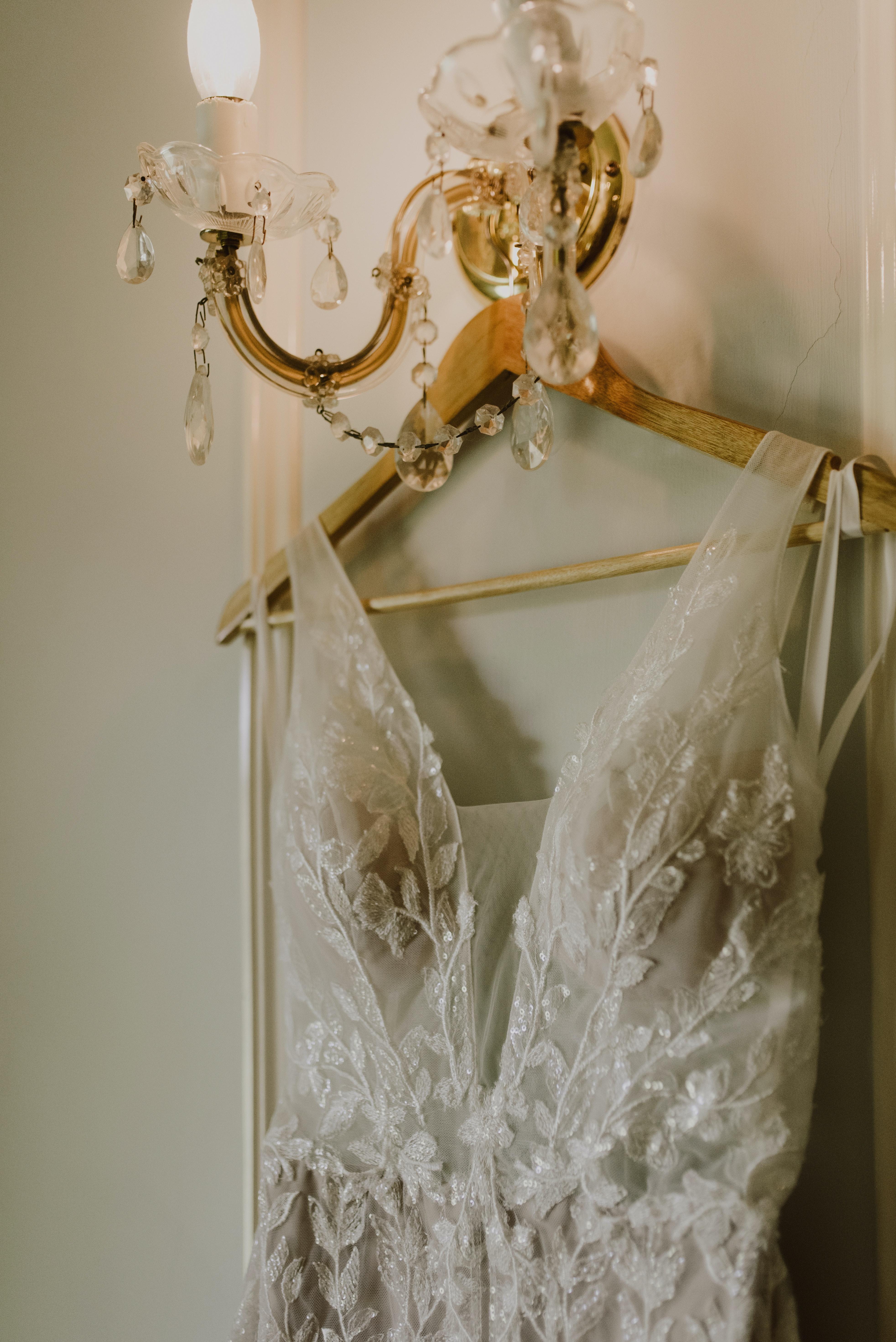 Wedding dress hanging from light