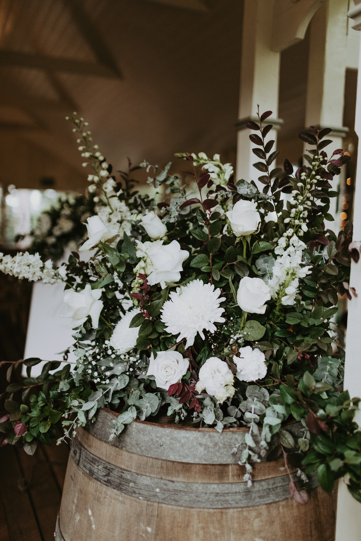 Florals on top of wine barrel