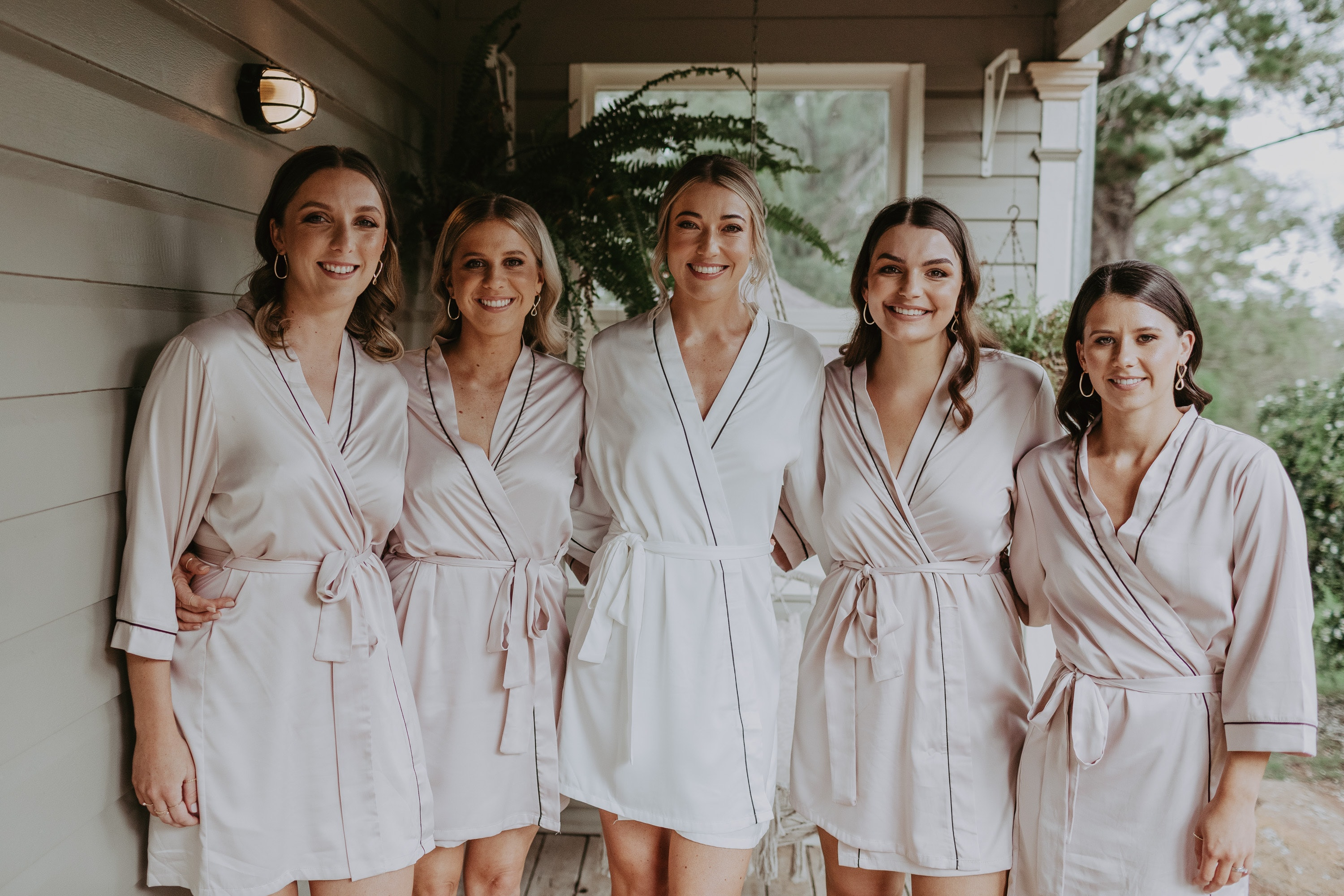 Bride and Bridesmaids standing together