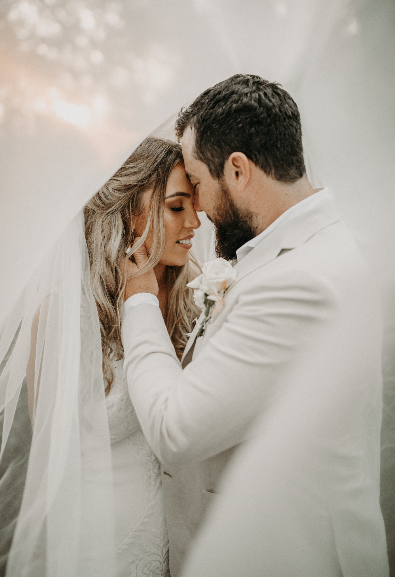 Bride and Groom touching faces