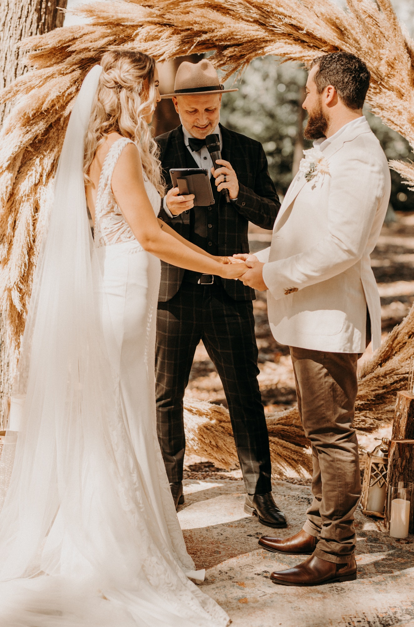 Bride and Groom standing at altar with celebrant