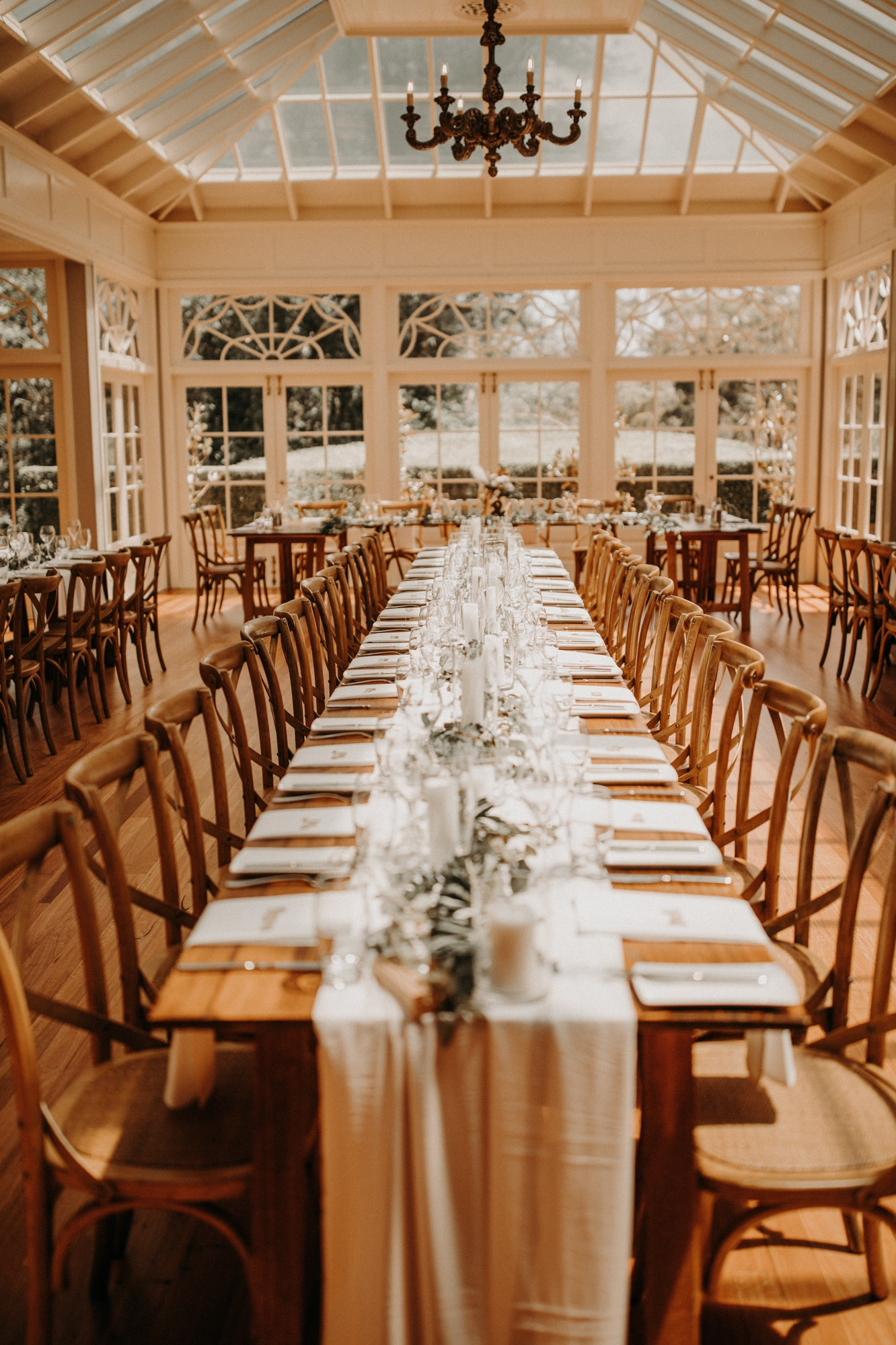 Wedding reception with wooden tables and chairs