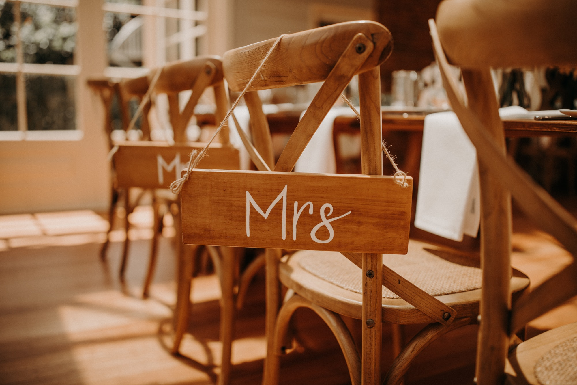 'Mr' and 'Mrs signs on the back of wooden chairs