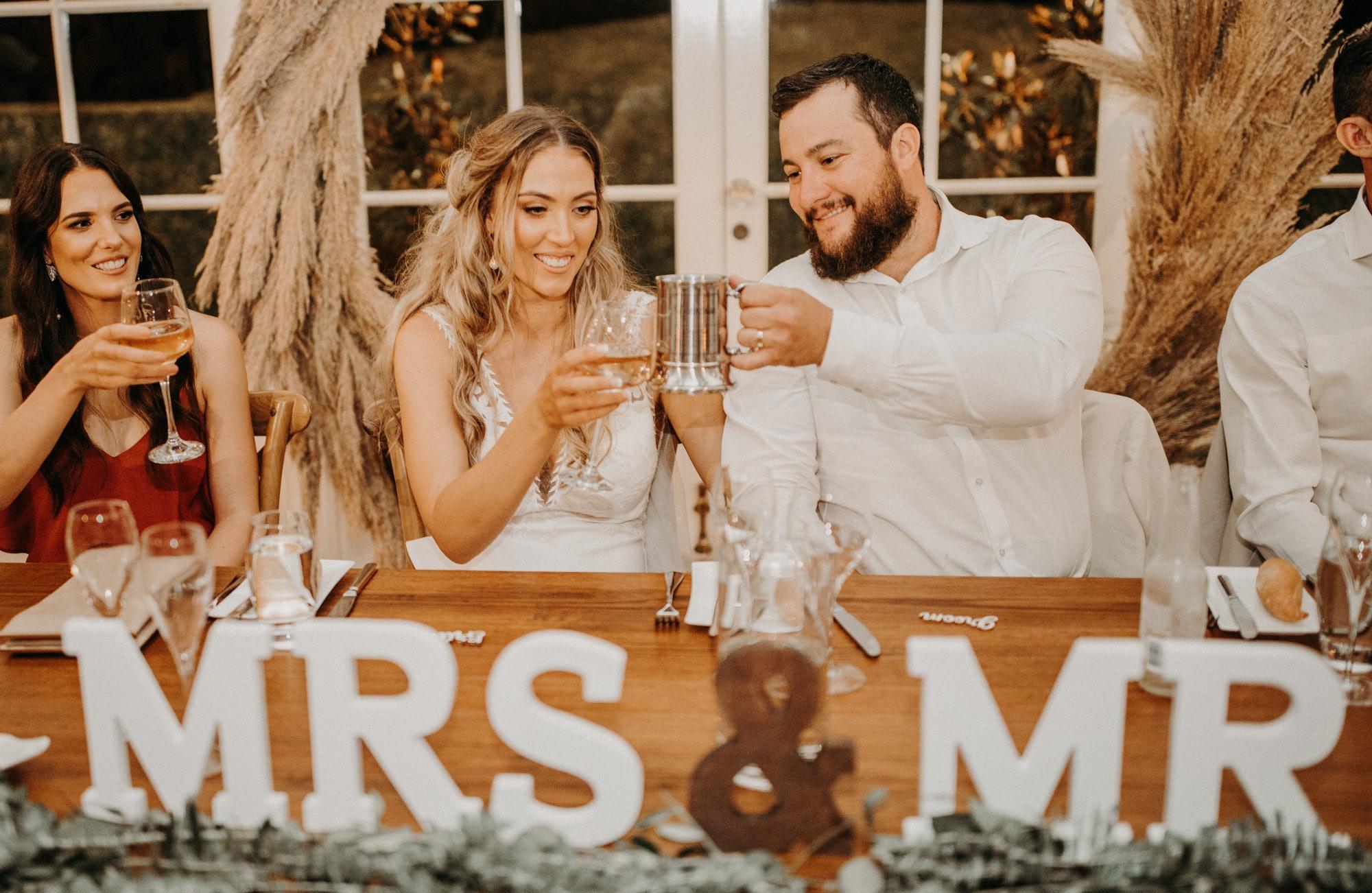Bride and groom toasting drinks