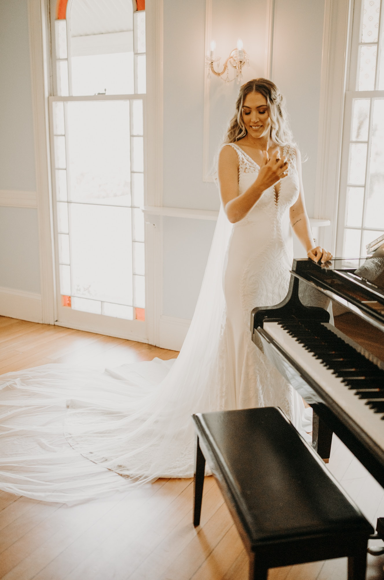 Bride posing near piano