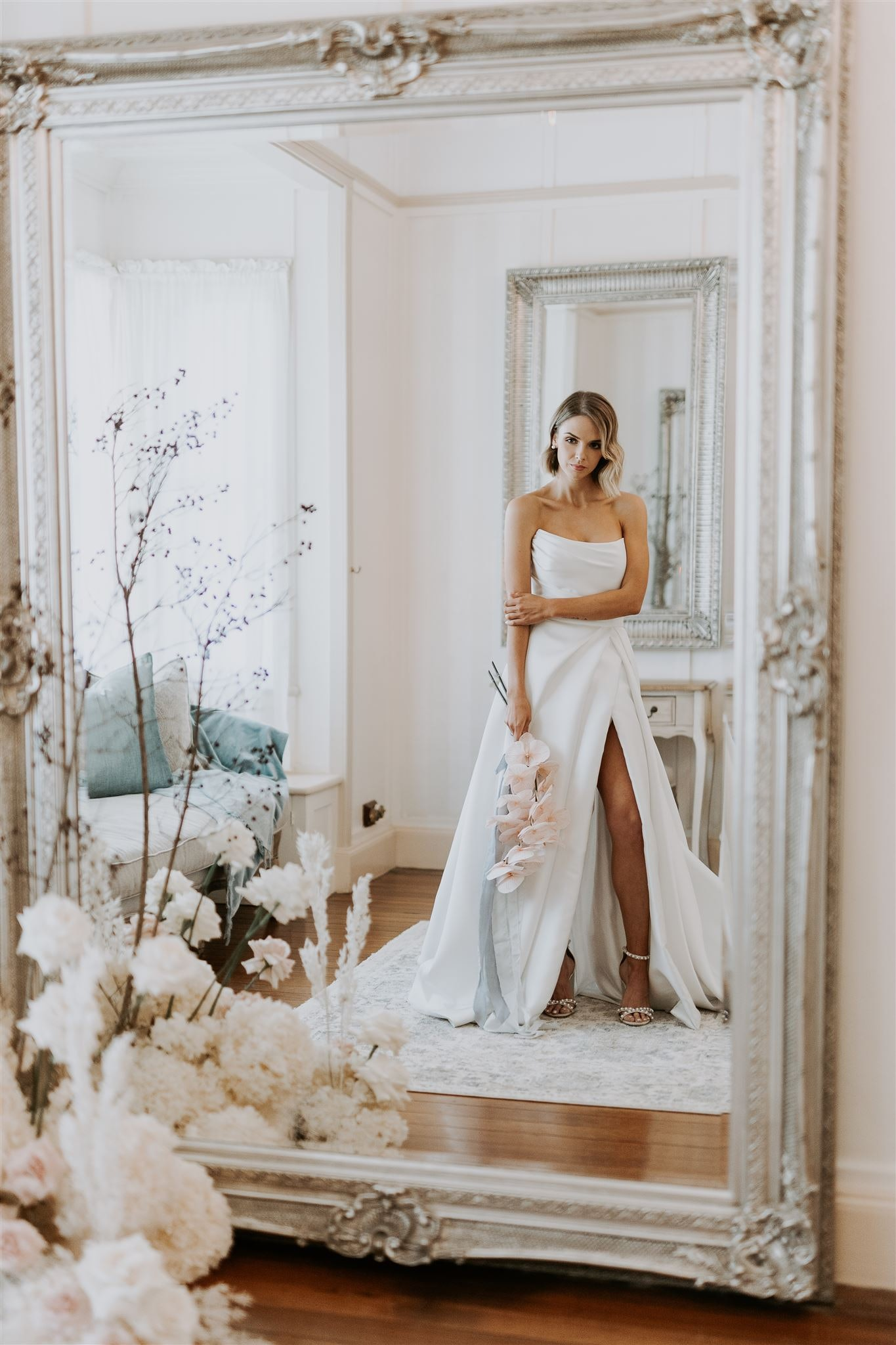 bride looks in mirror in bride's retreat