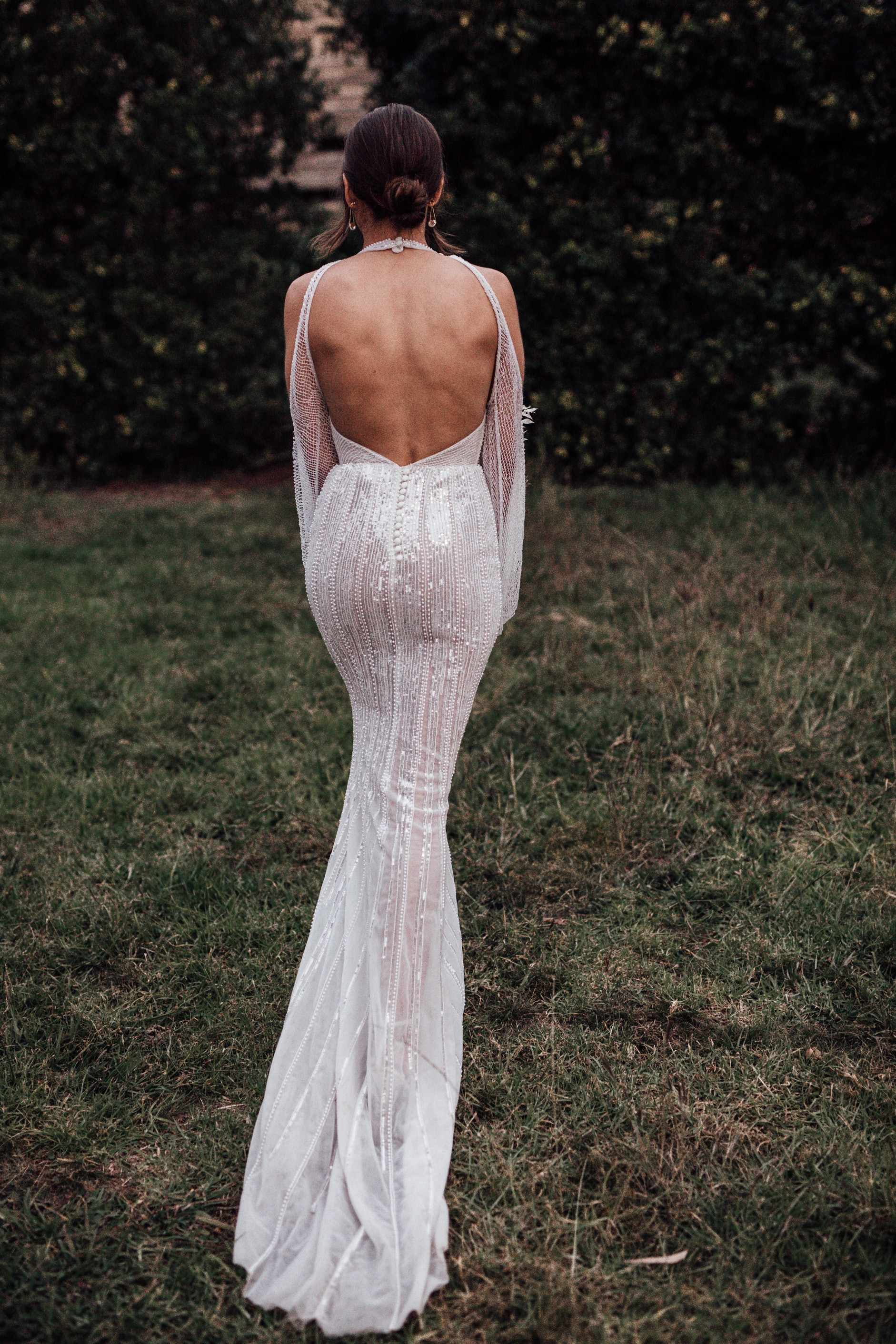 Bride showing the back of her dress