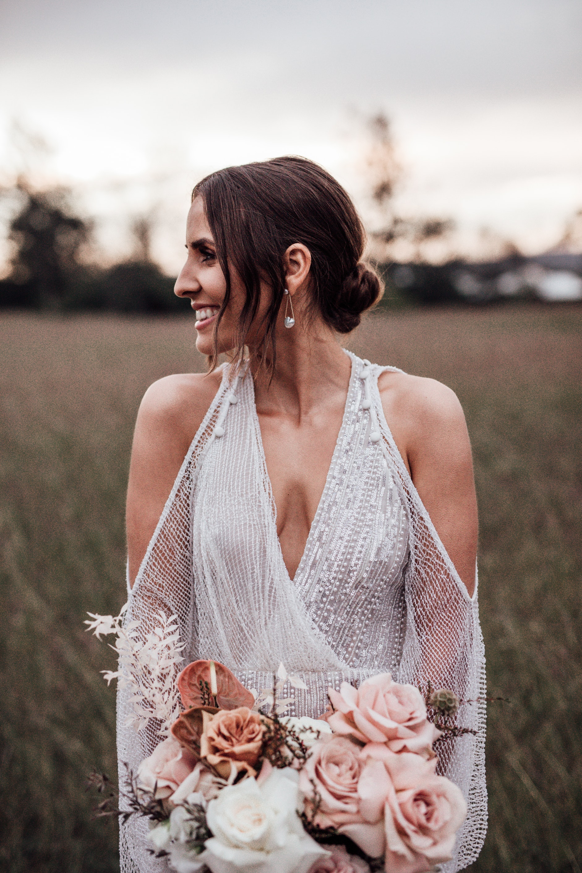 Bride holding bouquet and posing
