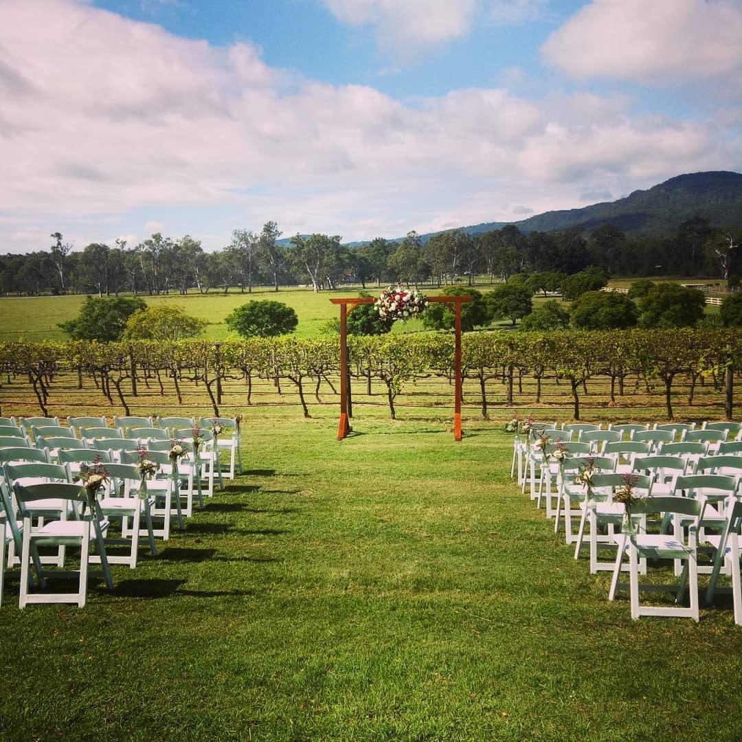 Wedding ceremony in front of vineyards