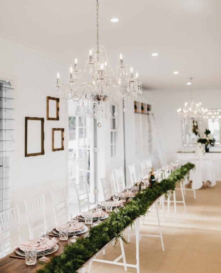 Wedding reception with long white tables