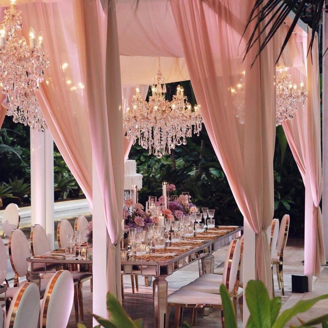Wedding reception under pavilion with chandeliers