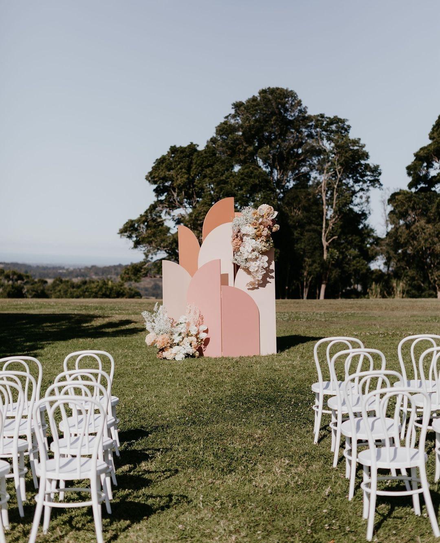Wedding ceremony with geometric arbour