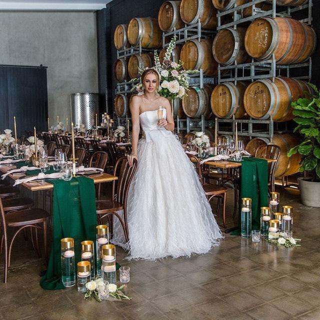 Bride at reception drinking wine