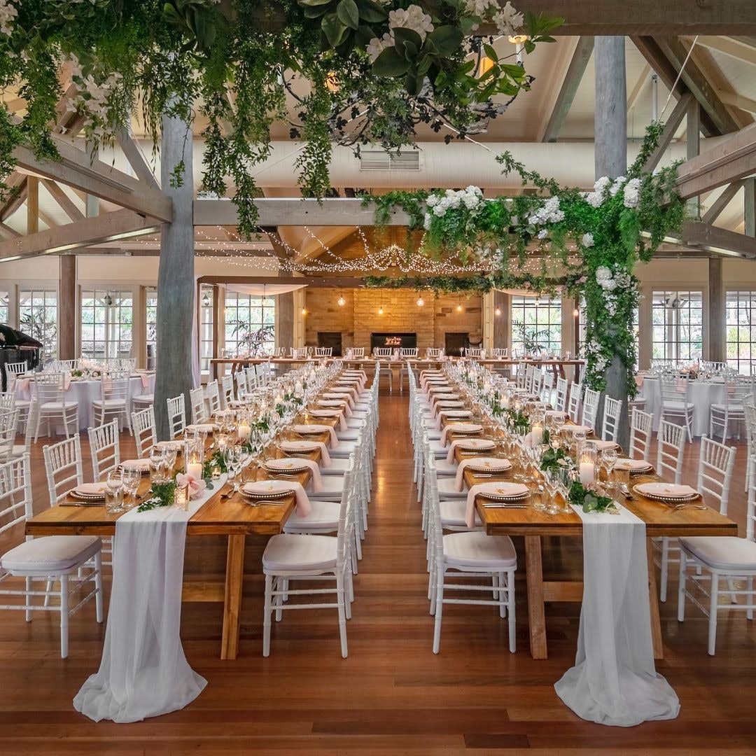 Wedding reception with white chairs