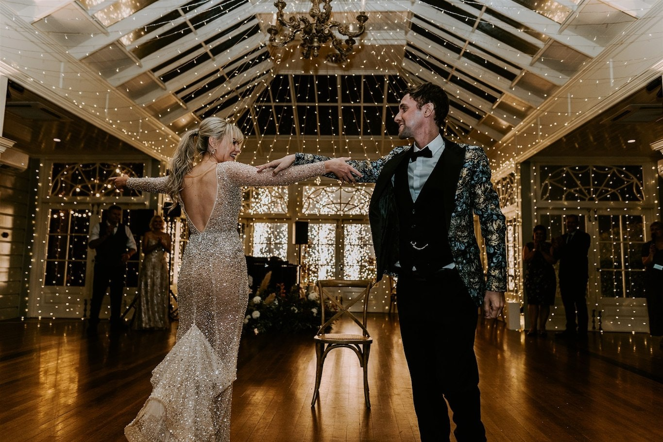 Bride and groom dancing in conservatory