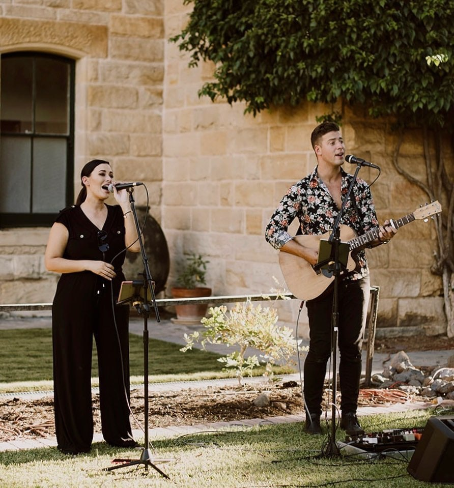 Man playing guitar and woman singing