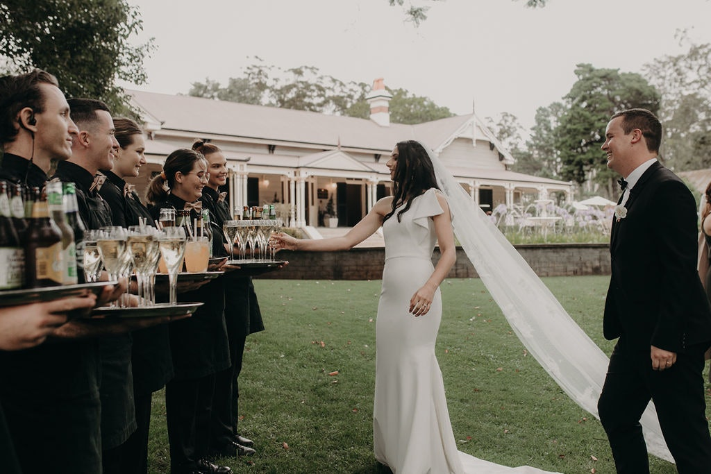 Bride and groom getting a drink