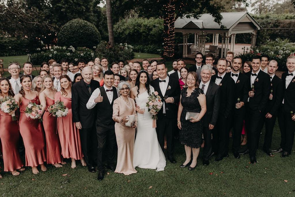 Wedding guests standing together in garden