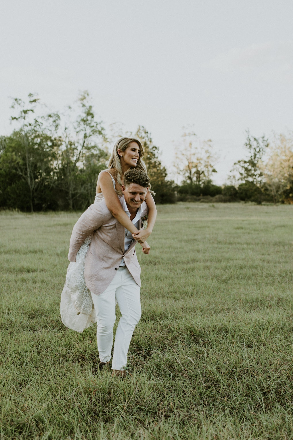 Bride and groom in fields