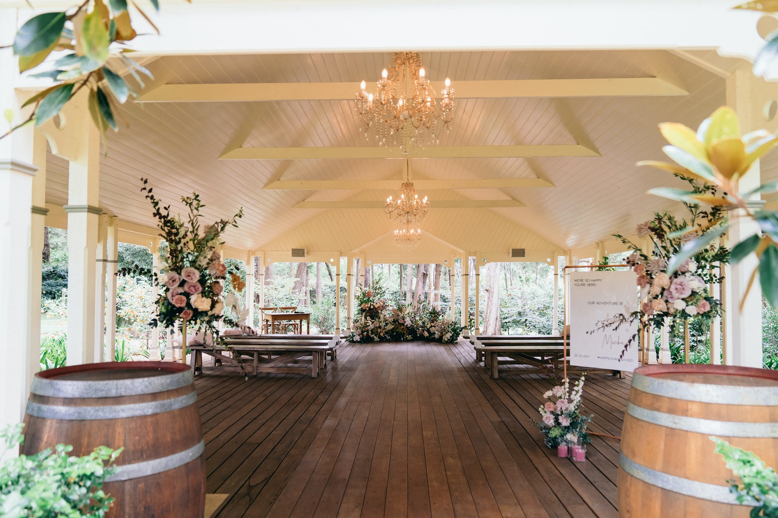 Wedding ceremony with flowers and bench seats