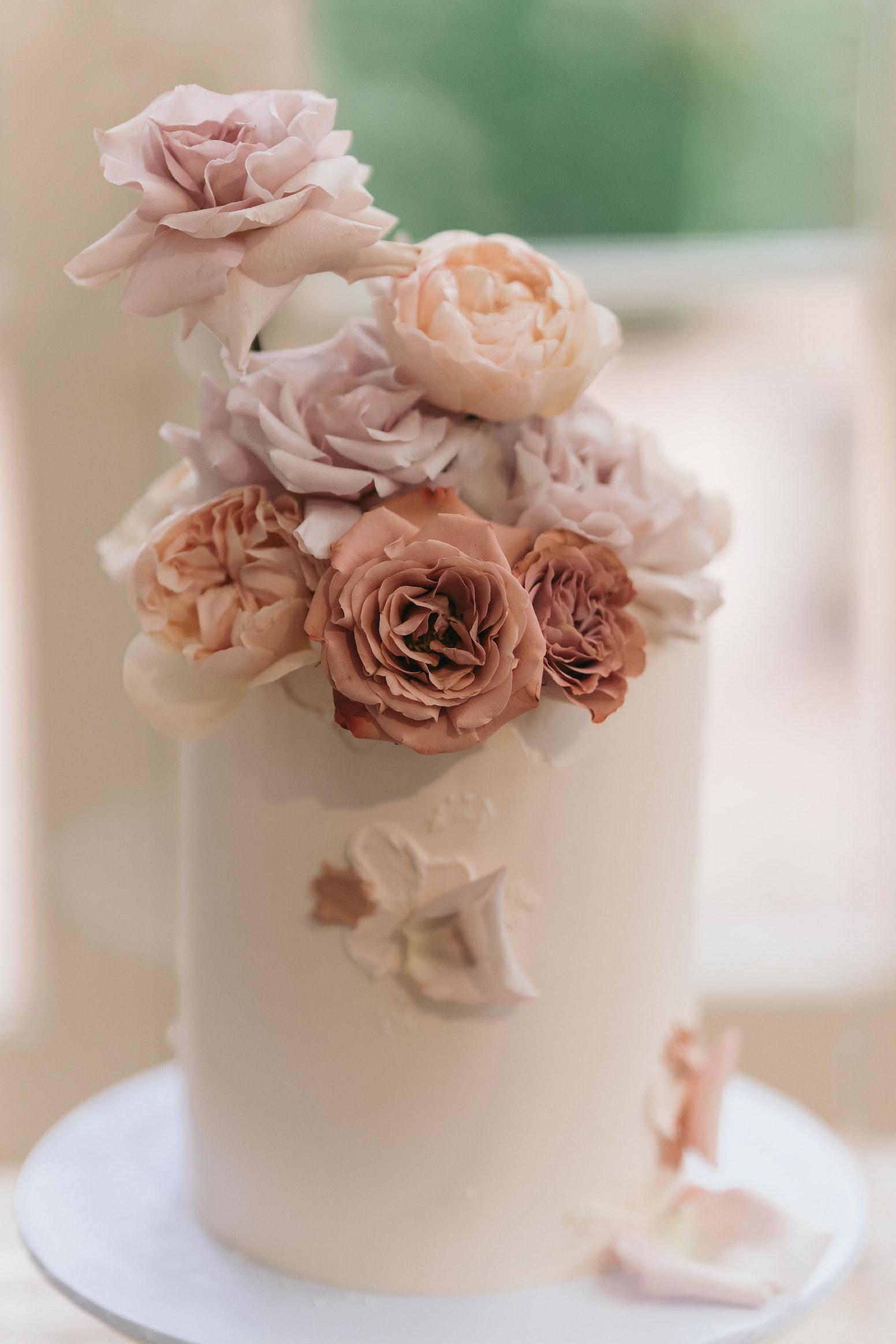 wedding cake with fresh flowers on top