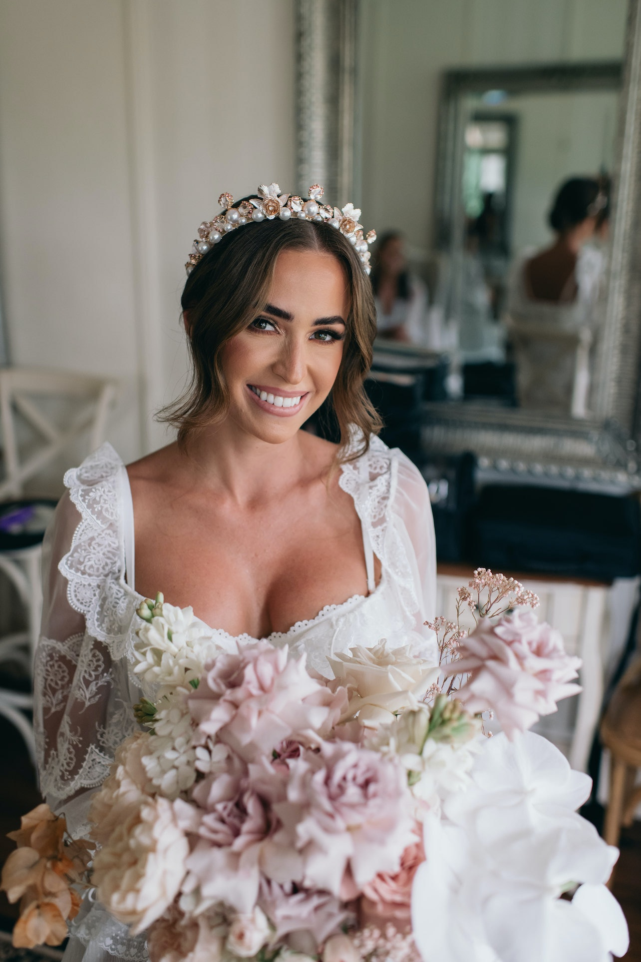 Bride getting ready holding flowers