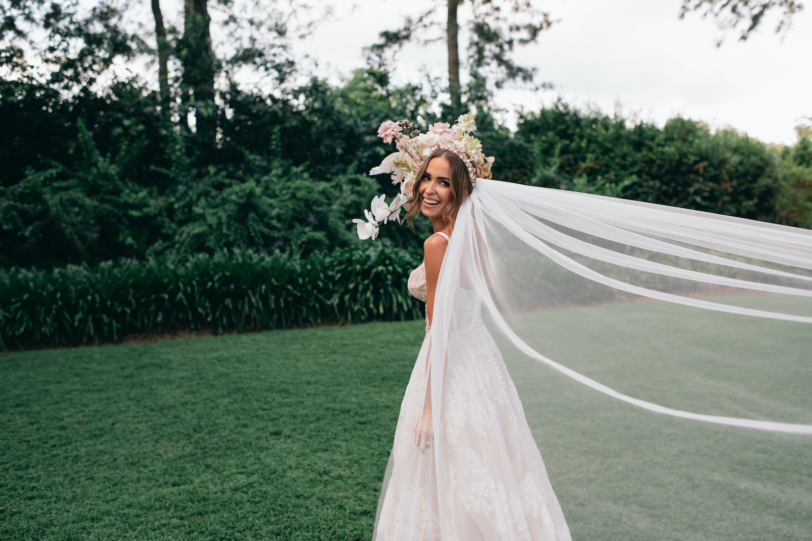 Bride in dress with long veil