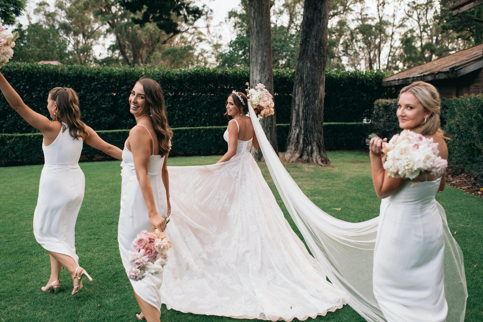 Bride and bridesmaid in gardens