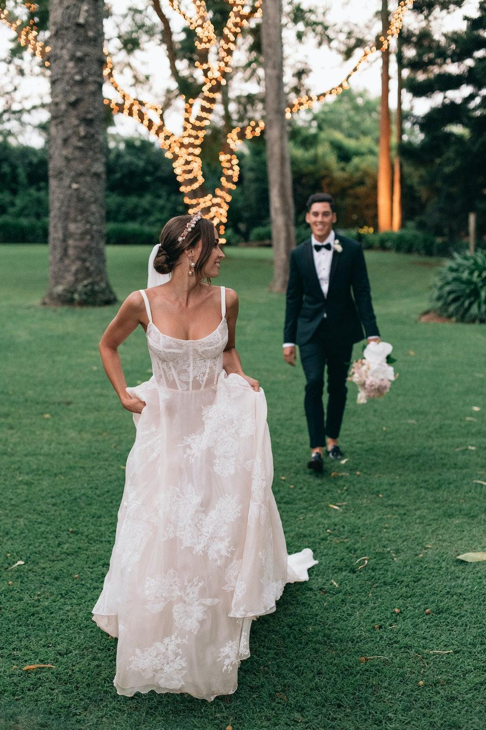 Bride and groom walking in gardens