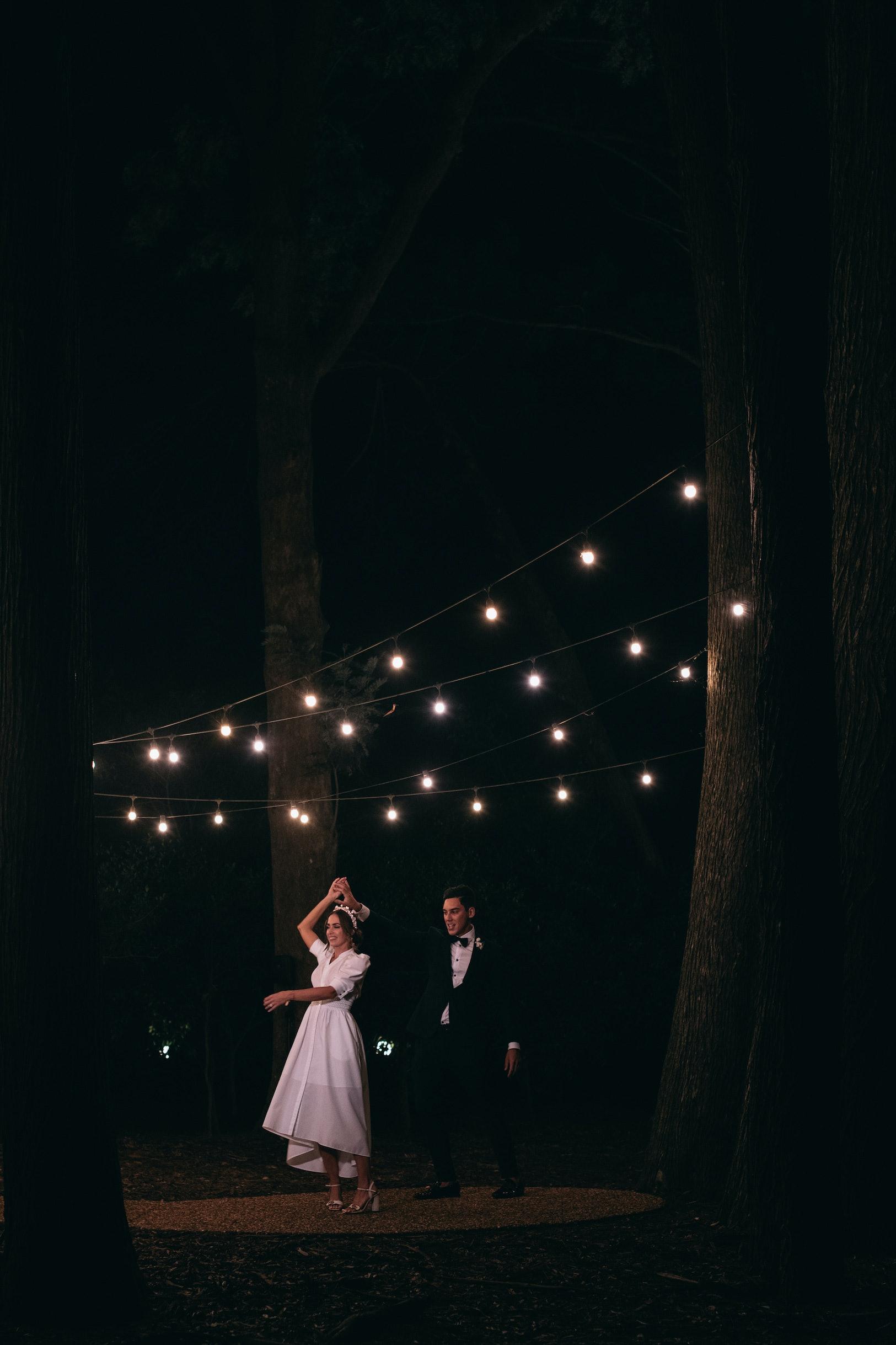 Bride and groom dancing outside