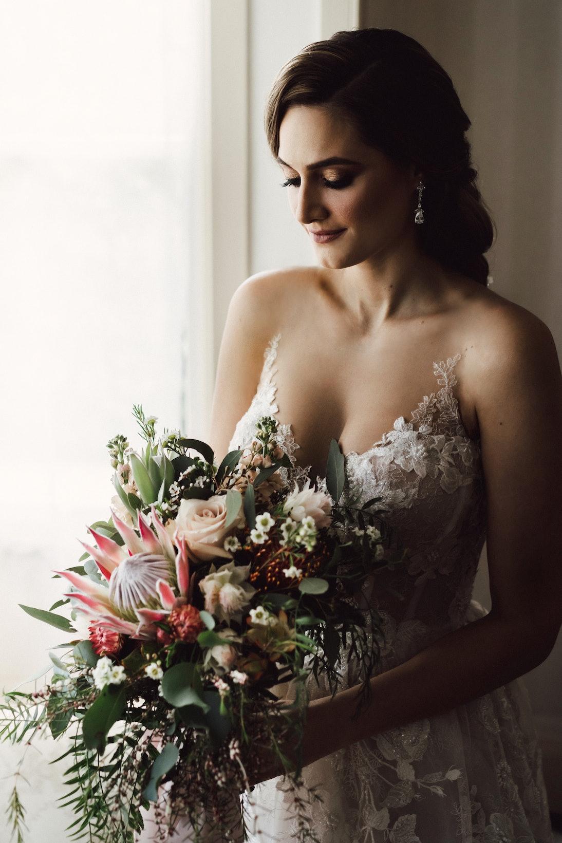 Bride holding bouquet in brides retreat
