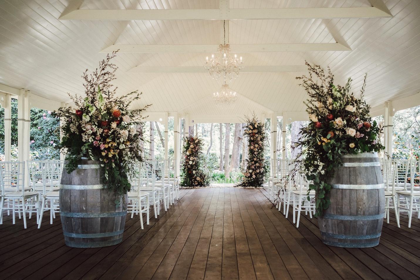 Flower arrangements on wine barrels in the pavilion