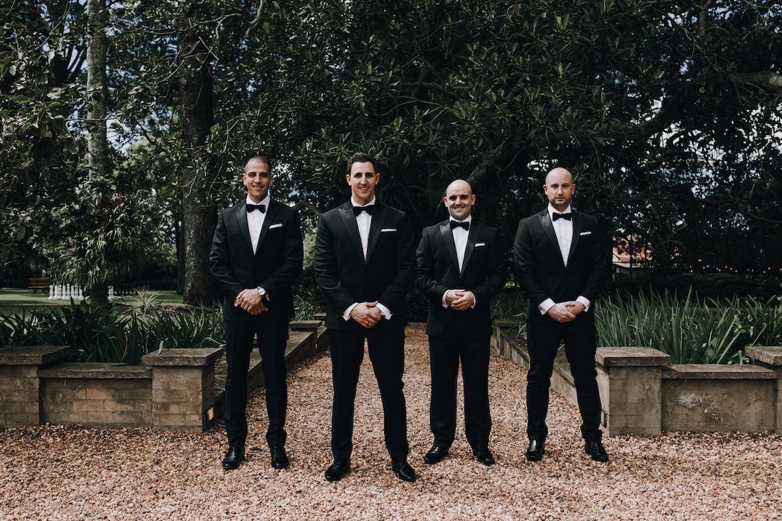 Groom and groomsmen posing together