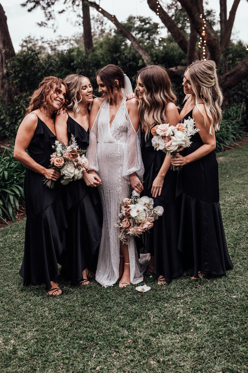 Bridesmaids gather around bride
