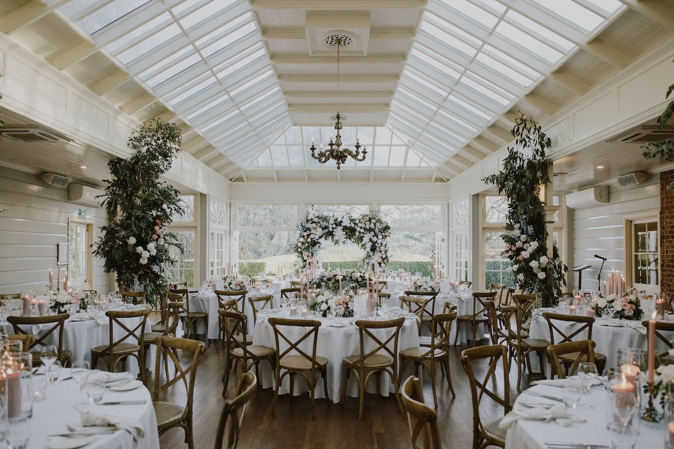 Gabbinbar Homestead conservatory set for a reception with floral arrangements