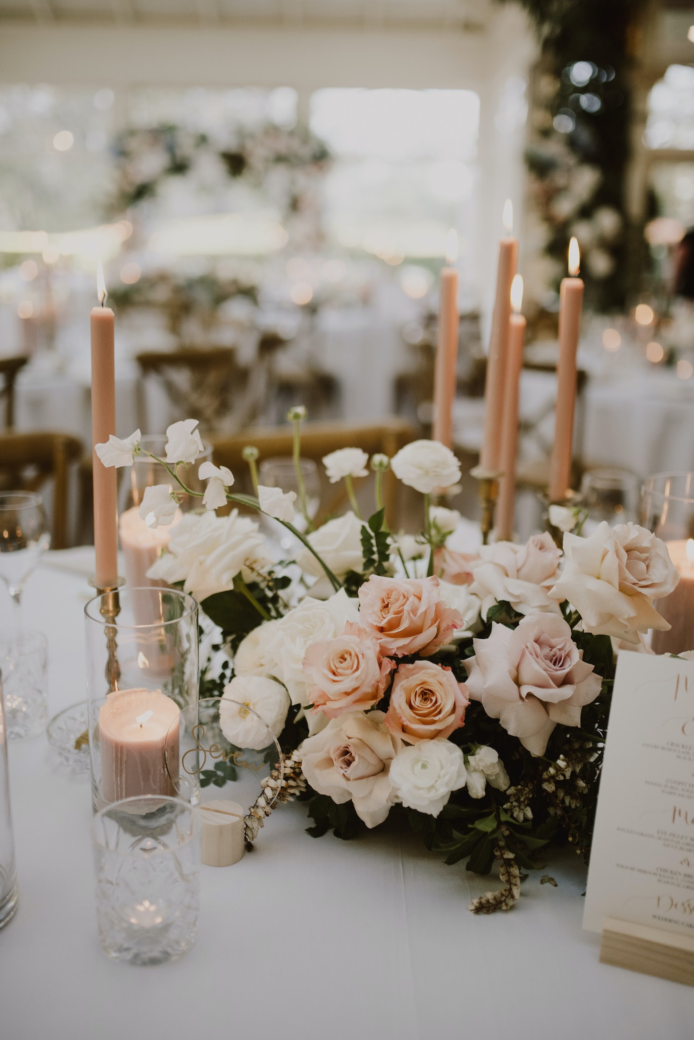 Wedding floral centrepiece with pink candles