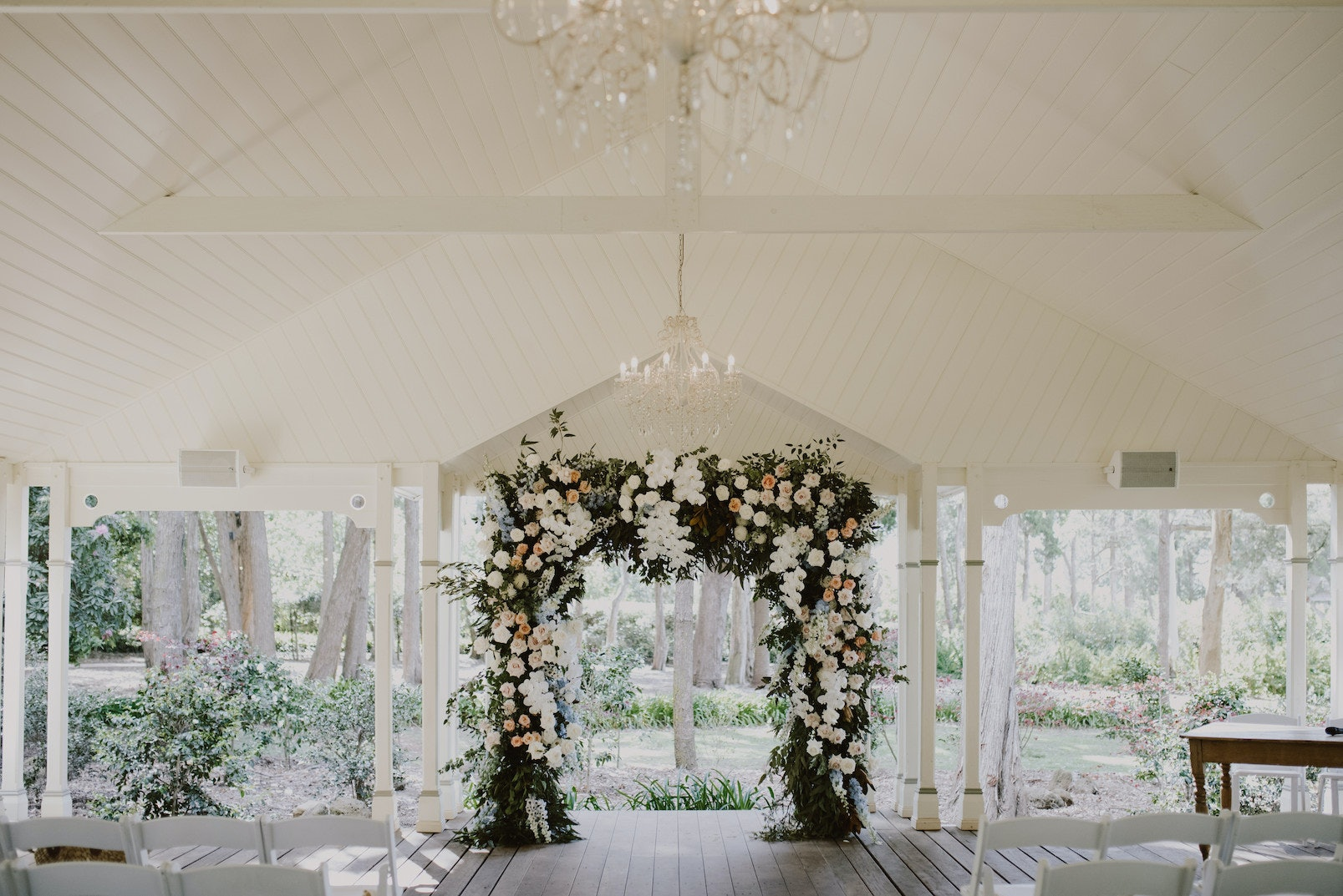 Floral laden wedding arbour in the middle of a wedding pavilion