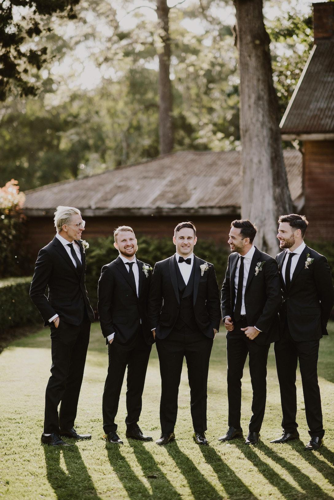 Groom and 4 groomsmen posing together